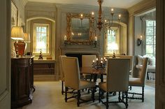 Beautiful dining room designed by architect Bill Litchfield with recessed windows, built in bookcase under the window, and a limestone fireplace.