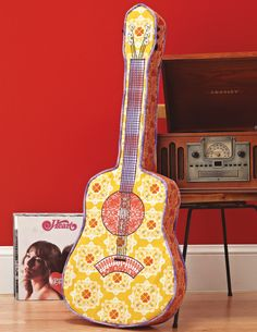 Get the free pattern from Sew it All Volume 4 and make a whimsical guitar pillow that's sure to impress any music lover.