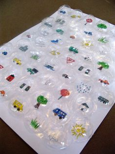 For a car trip - Place pictures under big bubble packaging -- as the kids see the things along the way, they pop the bubbles