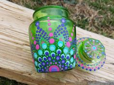 The green glass jar stands approximately 4 tall, includes a matching lid. The jar has been hand painted with a polka dot mandala design using various shades of non-toxic toxic acrylic paint. The jar has been heat cured to preserve the vibrant colors, making it safe to gently hand Stash Jars, Mandala Painting, Teal And Pink, Mandala Design, Pearl White, Preserve, Color Pop, Polka Dot, Vibrant Colors
