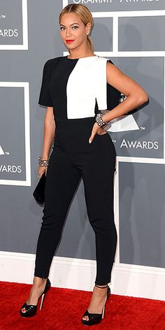 Beyoncé is many things, but she's certainly never boring. She keeps us on our toes by forgoing a gown and instead showing up in a funky color-blocked Osman pantsuit with matching geometric cuffs, a Swarovski clutch, a center-parted ponytail and bright red lips. http://www.peoplestylewatch.com/people/stylewatch/package/gallery/0,,20658244_20669662,00.html#