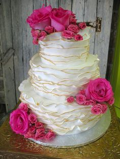 Wedding Cakes: Ruffled layered wedding cake with pink flowers and roses
