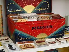 Old Perugina tin (some of the best Italian chocolate ever). I love the Art Deco design and the colors