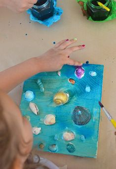 Seashell collages by kids, using tacky glue and liquid watercolor. Bible Crafts For Kids, Summer Crafts For Kids, Crafts For Kids To Make, Toddler Crafts, Preschool Crafts, Toddler Games, Kids Diy, Seashell Painting, Seashell Art