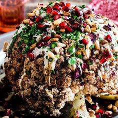 Cauliflower shawarma, pomegranate, tahini and pine nuts