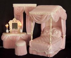 Site has a lot of dollhouse canopy bedroom sets; love the working vanity lights; adapt for fashion doll.