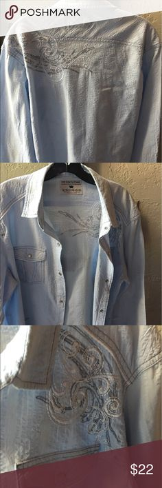 Men's Light Blue Style Shirt Men's Light Blue Style Shirt - Awesome shirt with some detail, snaps great with jeans. My husband didn't care for it so only worn once. Slim Fit 2XL but fits like slim XL POP ICON CLOTHING Shirts