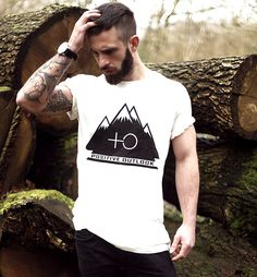 Beard, ink, and a cool tee.
