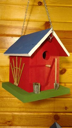 Country Springtime Garden Cottage Birdhouse made from All Re claimed Vintage barn wood and farmstead metals hammered galvanized into hand made miniatures, bucket, shovel , Window and Trellis adorn this Cute Garden House and will make a Wonderful present for yourself or someone