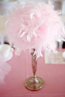 pink ballet ballerina birthday party feather boa topiary This would be soooo easy to make! Get a foam sphere and attach feather boa of choice then attach to candlestick or other perch of choice! Would look cool for baby shower, bridal shower, girls birthday party, ladies day luncheon. this is sooo masquerade