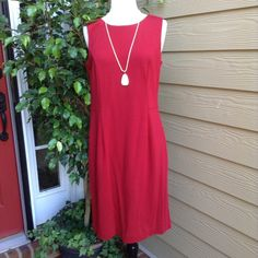 Chico's Red Dress Christmas red !!! Great for the holidays! This dress has never been worn. It is made of 70 rayon, 26 nylon and 4 spandex. The fabric is rather heavy and is appropriate for fall and winter. A cardigan or jacket and your all set. 37 inches from neckline to hem. Chico's Dresses