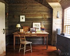 The walls and floors of the second-floor study are of barn wood, and the desk, chair, and chest of drawers are from various flea markets.