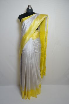 Plain style silver with lemon yellow border tissue uppada silk saree. Please visit our website for more details and to shop this product. Yellow Saree, Yellow Blouse, Saree Hairstyles, Plain Saree, Saree Models, Stylish Sarees, Image Processing, Lemon Yellow, Saree Collection