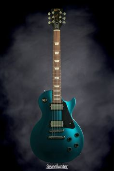 Gibson Les Paul Studio Pro - 2014, Teal Blue Candy   Sweetwater.com. Solidbody Electric Guitar with Chambered Mahogany Body, Maple Top, Mahogany Neck, Compound-radius Rosewood Fingerboard, 2 Humbucking Pickups, and Hardshell Case - Teal Blue Candy
