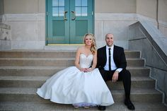 Bride and Groom posing for a picture on their wedding day outside the Vets Memorial Building captured by Michael Grobin Photography.