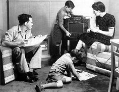 This is a picture of a family gathering around their radio. In the many families would gather around the radio for hours for entertainment, it being the 'new' and cool technology of the time period. It shows that they were developing electronically. Nazi Propaganda, Radios, Pittsburgh, Detroit, Bbc, I Walk Alone, Nuclear Family, Radio Antigua, Family Fun Games
