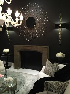 WOWZERS! I am awestruck by the starburst mirror! Doesn't it look absolutely #FABULOUS hanging above this mantel?! #InsideStyle #LVMKT