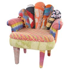 Mango wood accent chair upholstered with one-of-a-kind vintage kantha throws.   Product: ChairConstruction Material: M...