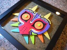 Hey, I found this really awesome Etsy listing at https://www.etsy.com/listing/212735147/majoras-mask-layered-paper-cut-art-piece