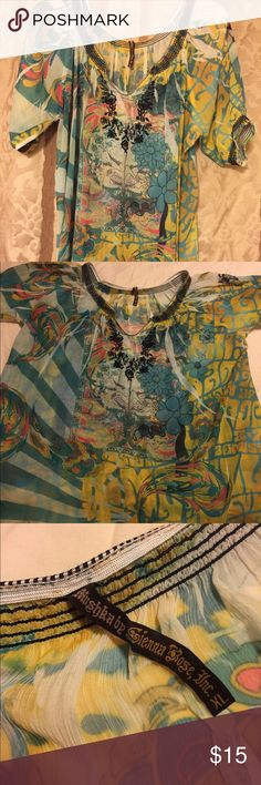 Graphic sheer blouse Pretty floral graphic designed sheer v-neck see through blouse with cinched stitched sleeves. Black floral stitching under the neck line. Very loose and long. Hardly worn. Tops Blouses