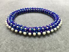 This beautiful beaded bangle just slips over your hand.  See photos for other colours it has been made in.  Also available made to order in different colours.