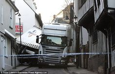 Ignoring roadside warning signs, the driver turned his 30-ton lorry into this narrow lane, jack-knifing on the tight corner before becoming stuck.As he tried to manoeuvre his rig free, one of the lorry's tyres exploded causing even more damage. The bill for his error was made up of £80,000 of spilled olive oil, £15,000 damage to a 17th century house and the writing-off of the £20,000 trailer. It took 16 hours to free the HGV.