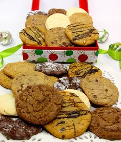Whether that special someone is a glutton for gingersnaps or a chocolate fiend, customize your cookie box with whatever assortment will speak to their heart and their stomach.  This unique tower is a great way to let someone know you're thinking of them this holiday season, or to bring a little extra joy to gathering of either family or friends.