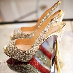 Apply glue w/a paint brush or Q-Tip in small places, then sprinkel generously w/glitter!  Shake off excess and let dry for @ least 24 hours if you can! And watch your shoes sparkle :)