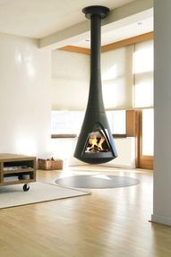 modern fireplaces, hanging fireplace design ideas for contemporary home interiors Suspended Fireplace, Floating Fireplace, Hanging Fireplace, Mounted Fireplace, Open Fireplace, Fireplace Design, Wood Burner, Contemporary Interior Design, Home And Living