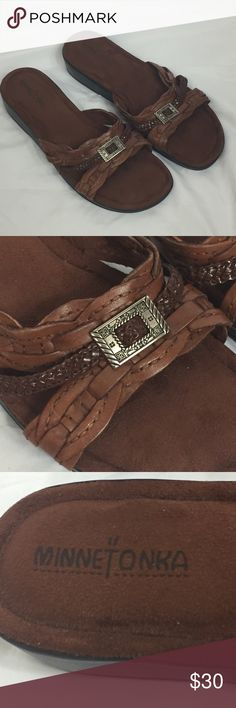 Minnetonka Leather Sandals Size 9 NWOT NWOT  Leather upper and man made balance Braided leather and silver tone medallion for over the foot Surfed leather footbed Please see pictures for details Closet Minnetonka Shoes Sandals
