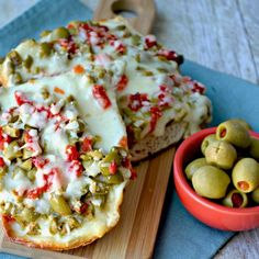 Ooey gooey Cheesy Olive Bread makes a delicious appetizer, lunch, or anytime snack!