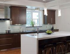 White waterfall countertop on island but black on rest of the counters.  Nice lights over the island.
