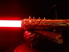 the BLOOD WYRM lightsaber by Borax- winner of the custom saber shop lightsaber contest 2011.