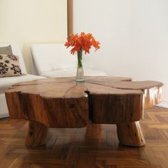 $1,624.95 - Grand Coffee Table  - Designed from salvaged  patagonian cypress trees. Each accent piece is unique in style natural   beauty  character. Some of our wood is close to 200 old. We   welcome our clients to visit Patagonia and pick the fallen tree from   which to make their tables. Each table comes with a booklet telling the   story of who we are and a bronze plaque indicating the age of the tree.
