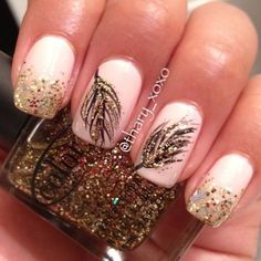 Beautiful white and gold nail art design with leaf patterns. The leaf patterns are drawn in thin black polish and supported with gold glitter on top as well as gold glitter on the french tips as well.