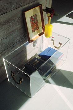 Nautical rope handles on a sleek box made of crystal-clear Lucite