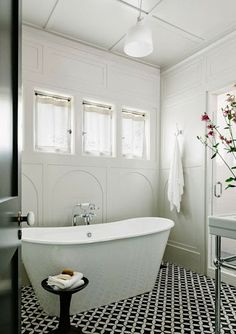 Cement tile floor in black and white.  Stand alone tub!  Love