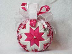 Items similar to Valentine's Day Quilted Ornament - no sew – red, pink and white heart fabric, pink center, love ribbon, white and pink bow, and a love charm on Etsy
