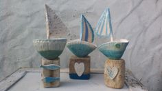 Three driftwood and ceramic sailboats from @Skelligpottery