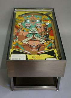 Relive your 1970s youth with this charming and unusual vintage pinball machine coffee table.