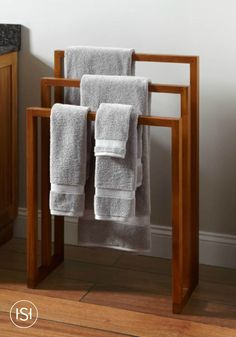 Add a dose of luxury to your guest bathroom makeover with a modern wooden towel holder. Its earthy style makes this bathroom decor perfect for your spa-like retreat.