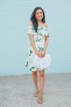 Off the shoulder lemon print dress with a white acrylic bag for summer