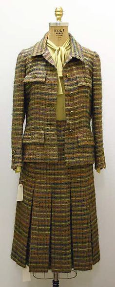Suit  House of Chanel (French, founded 1913)  Date: fall/winter 1976–77 Culture: French Medium: (a, b) wool; (c) silk
