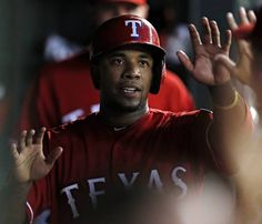 Texas Rangers shortstop Elvis Andrus high-fives teammates after scoring during the second inning against the Seattle Mariners Saturday, September 19, 2015 at Globe Life Ballpark in Arlington, Texas. (G.J. McCarthy/The Dallas Morning News)