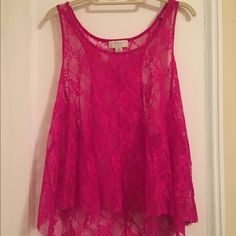 Pink Floral Tank Top Pink floral tank top. It is a high low top. 90% Nylon 10% Spandex. See through. Only worn once. Great condition! Forever 21 Tops Tank Tops
