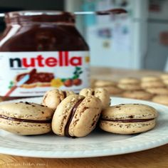 Coffee nutella macarons , Directions: 1. preheat oven to 350º f (180º c). 2. line two baking sheets with parchment paper and have a pastry bag with a plain tip (about 1/2-inch, 2 cm) ready. 3. sift together the powdered sugar, almond meal and 2 tablespoons of espresso so there are no lumps (usually i just use a fork to break any large lumps). if your almond meal isn't so fine, you can put the ingredients into a blender or food processor to make it finer. personally, i'd just use the sifter…