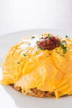 Omurice - Chicken fried rice with a blanket of soft scrambled eggs on top.