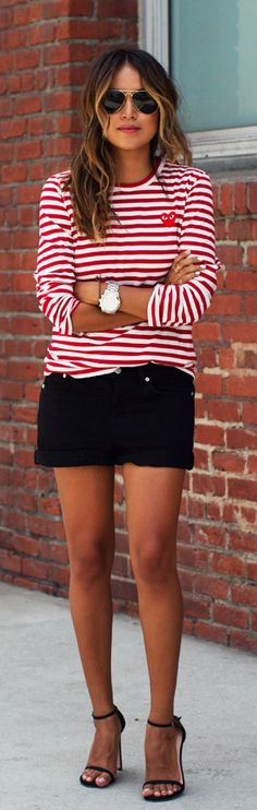 Julie Sarinana is wearing a red and white red striped top from Comme Des Garcon, black denim boyfriend shorts from Madewell and the shoes are from Stuart Weitzman