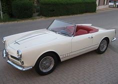 beautiful 1962 Alfa Romeo 2000 Spider. My little dream car. I sat in one once. It was love at first sight.