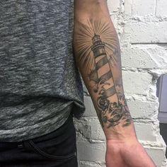 Grey Ink Left Forearm Lighthouse Tattoo